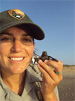Alumna Serra Hoagland with baby turtle