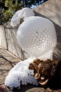 Image of project made of cups, resembling the shape of a golf ball
