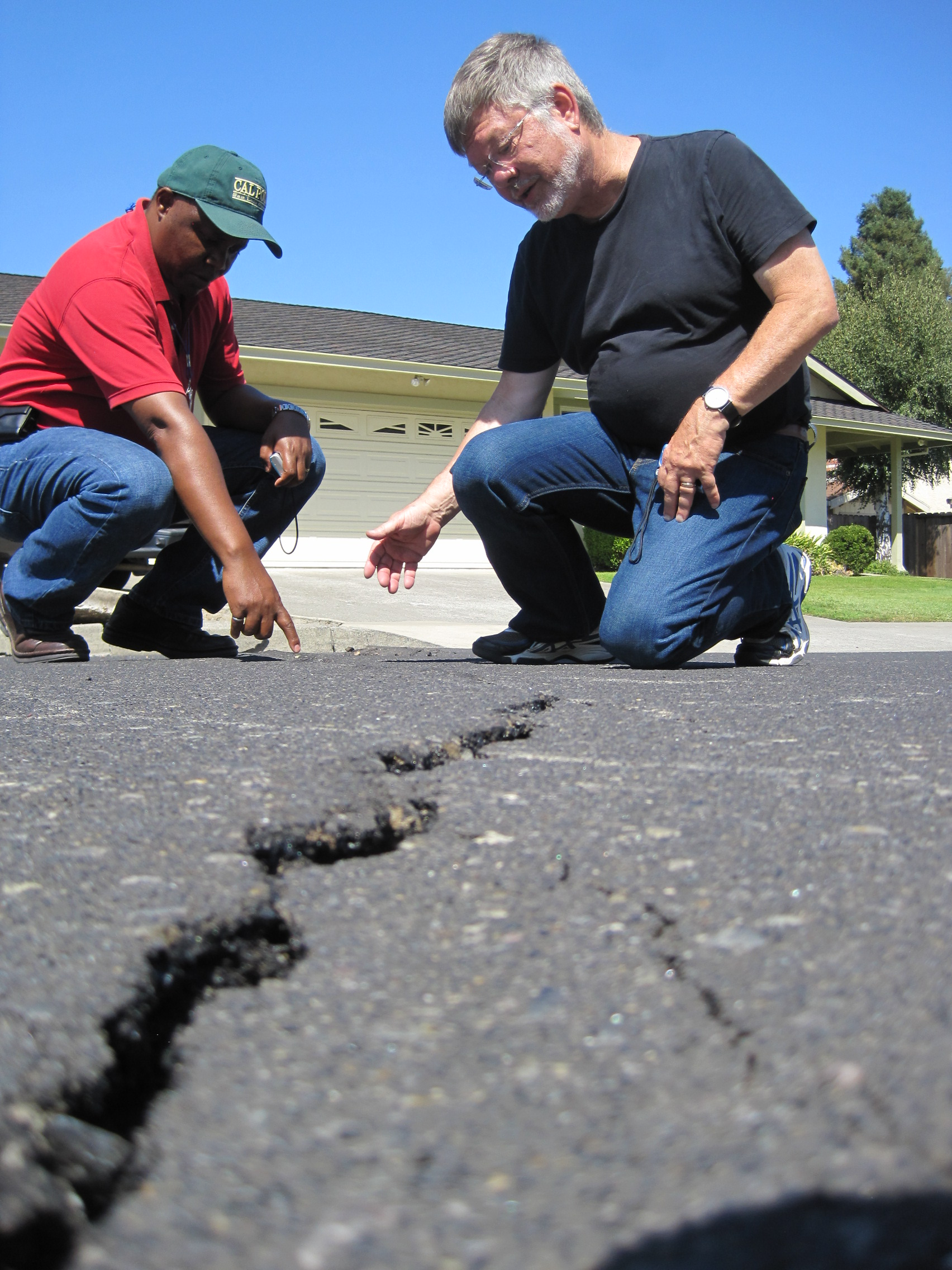 CAED Faculty examine damage to road following the Napa, Calif. earthquake.