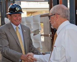 Chancellor White shakes hands with Construction Management Department Head, Al Hauck