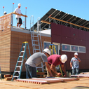 Picture of people building the solar decathlon house
