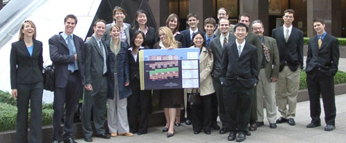Photo of winning team of students and their advisors