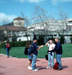 Students standing on the walk beside Dexter Lawn looking at the Architecture building