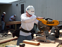 Student using a chop saw