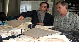 Image of two people discussing a student project.