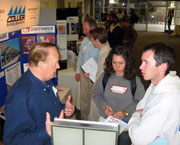Students talking with a business expert at the 2008 CSI forum product show