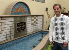 Photo of Wade Sherman standing in front of the fountain in the Healing Garden
