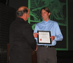Photo of Russell Hilken receiving AIA Award