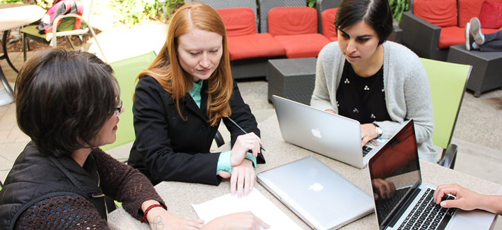 STS Program Director Jane Lehr and Professor Laura Hosman discussing a project with students.
