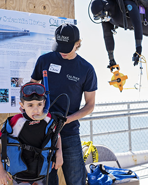 Image of child in SCUBA gear with instructor