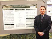 Zach Petrek and his research poster