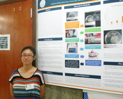 Two students with their research poster