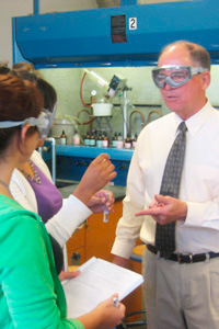 Dean Philip Bailey teaching chemistry laboratory exercise