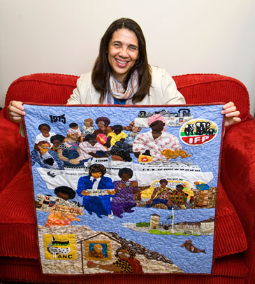 Denise Sheridan with her quilt commemorating the struggle against apartheid in South Africa
