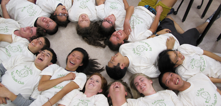 Student Clubs banner image; students lying on the ground in a circle.