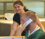 Student staff answering phones in Housing office