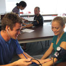 Photo of students testing blood pressure