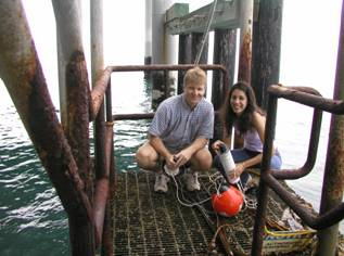 Student and teacher doing research at the Cal Poly Pier.