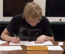 Brian Jones works on the Putnam Math Exam. Jones was Cal Poly's top scorer with 30 points. The median score at this year's competition was one.