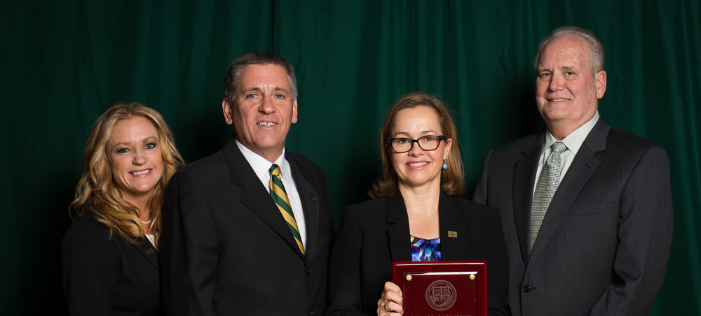 (Left to right) Kristie Boyett, Cal Poly Alumni Association President; President Jeffrey D. Armstrong; Kelli Seybolt; and Douglas Epperson, Dean of the College of Liberal Arts