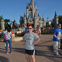 Megan Whitworth standing in front of Disneyland