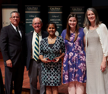 Soma Roy with her award and President Armstrong, Dean Bailey, a student, and Provost Enz Finken