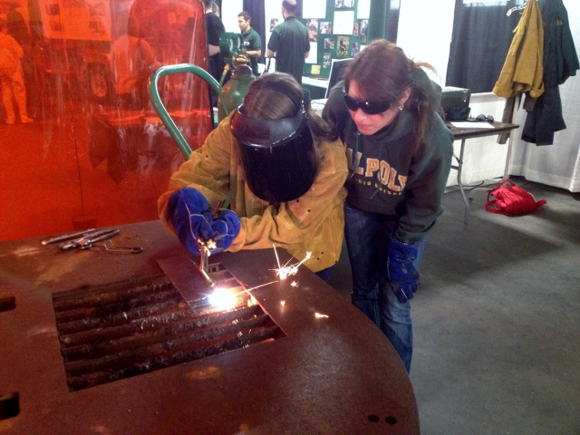 Graduate student demonstrating use of oxy-acetylene torch