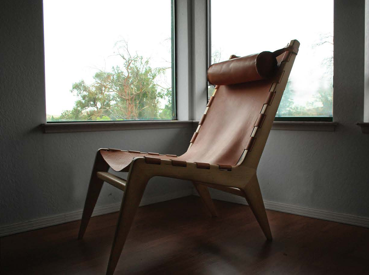 leather and wood chair by Mackenzie Stickney