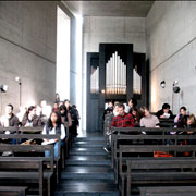 Students sitting in pews in a curch