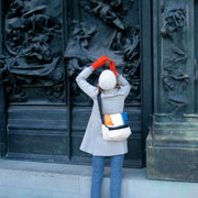 Student photographing an historic door