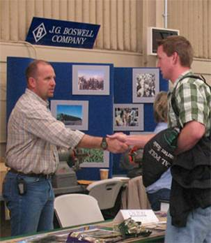 Student shaking hands with recruitment representative at the Career Fair