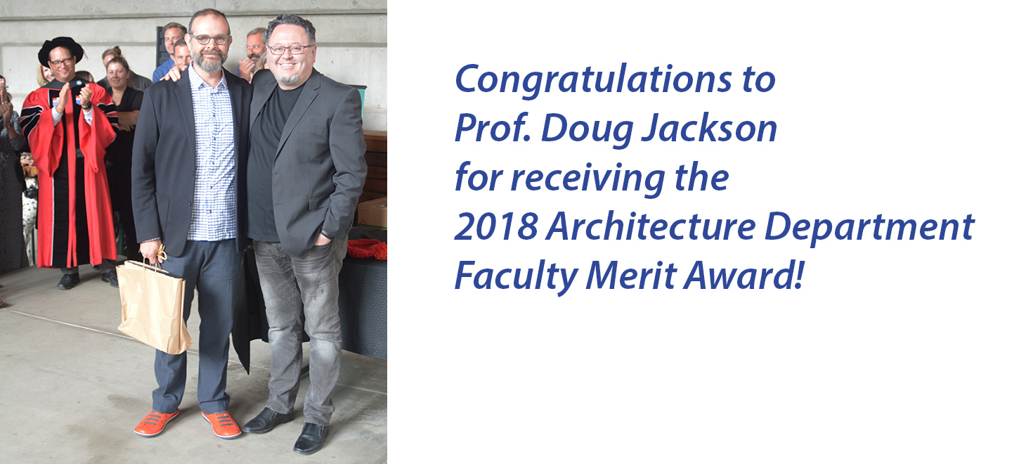 Professor Doug Jackson standing with Professor Umut Toker to receive the 2018 Faculty Merit Award