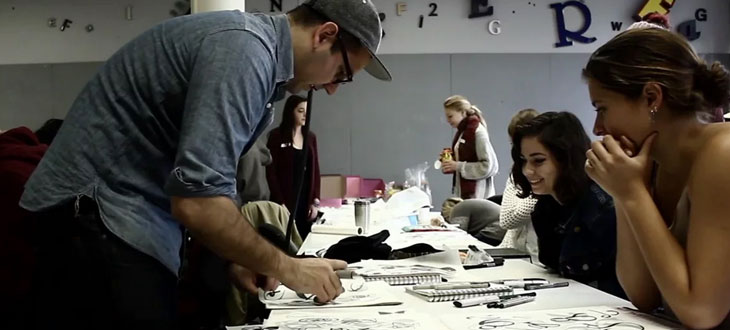 Erik Marinovich leading a workshop with Cal Poly Art & Design students