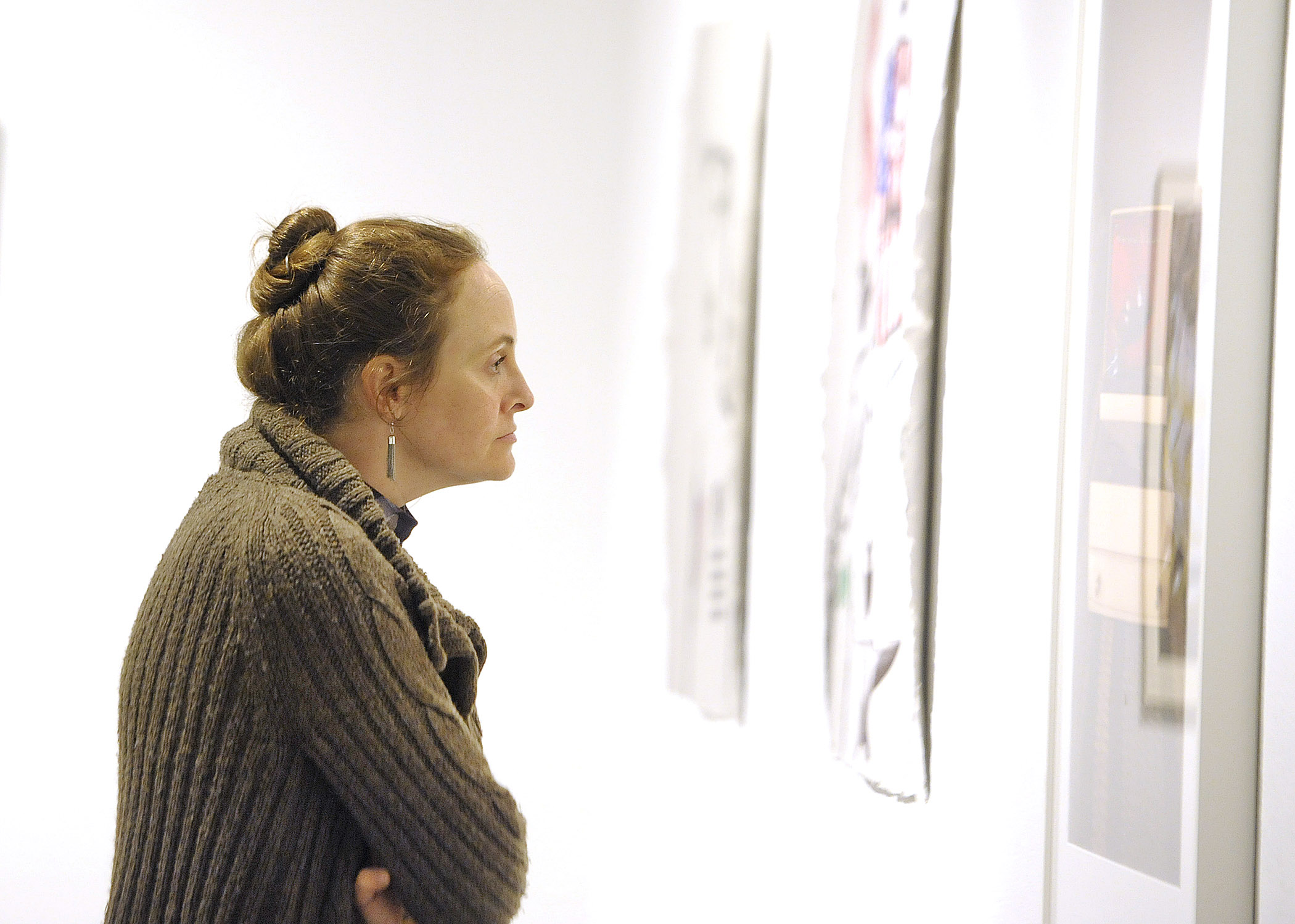 Woman Looking at Artwork by Dirty Canteen