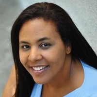 Picture of lead coordinator Anya Booker smiling at the camera