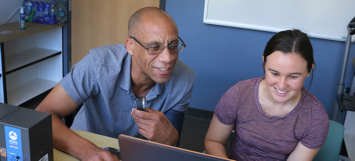 Professor Michael Whitt teaching student Tamiko Saldin
