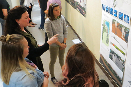 Cal Poly landscape architecture students and a faculty member exchange ideas during a critique of their design concepts and solutions.