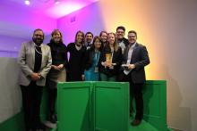 Photo of students and Department Chair Margot McDonals with award