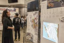 Christy O'Hara, a faculty member in Cal Poly's Landscape Architecture Department, reviews the work of the Winter Quarter 2019 Fifth-Year Landscape Architecture Showcase.