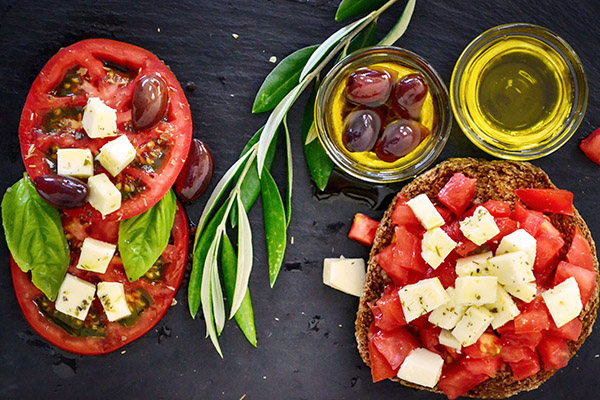 Photo of tomatoes, feta, olive oil and Greek olives