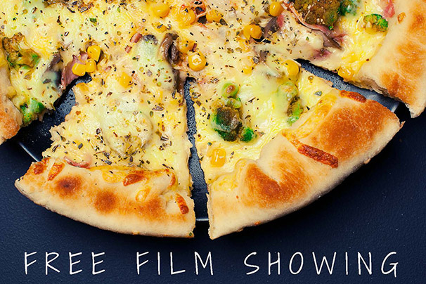 Close-up photo of several slices of pizza with text reading Free Film Showing