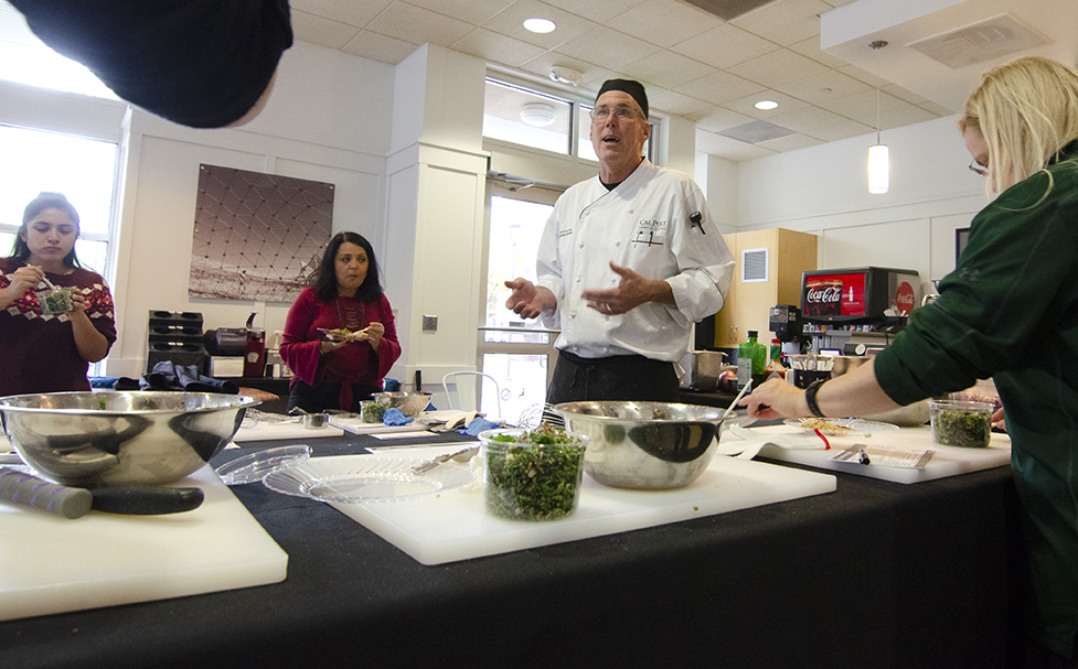 Photo of one of the Campus Dining chefs and class participants during a Cooking in the Canyon class.