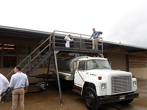 Photo of BRAE students on the bridge above the truck so they can easily access the top hatch.