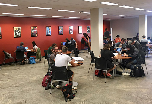 Photo of students studying and writing at the Writing and Learning Center at Kennedy Library.