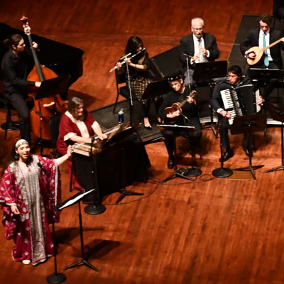 Photo of performers at a previous Arab Music Ensemble performance.