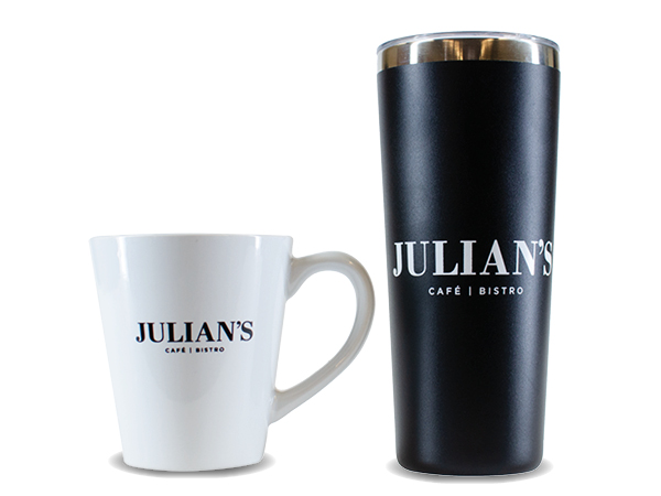 Photo of two reusable coffee mugs reading Julian's Cafe Bistro