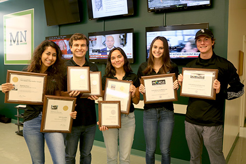 Mustang Media Group members pose with their recent awards.