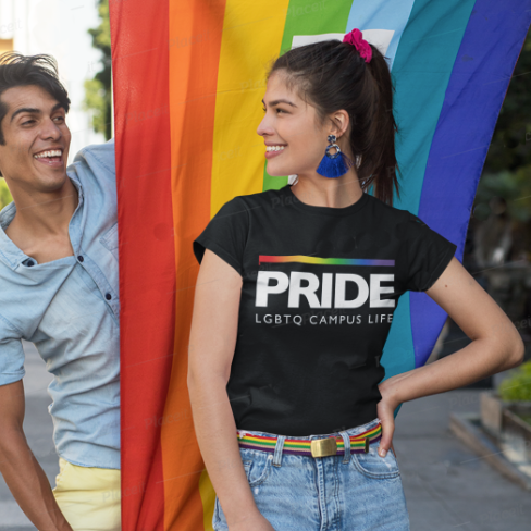 Two people smiling at each other with a rainbow flag in background