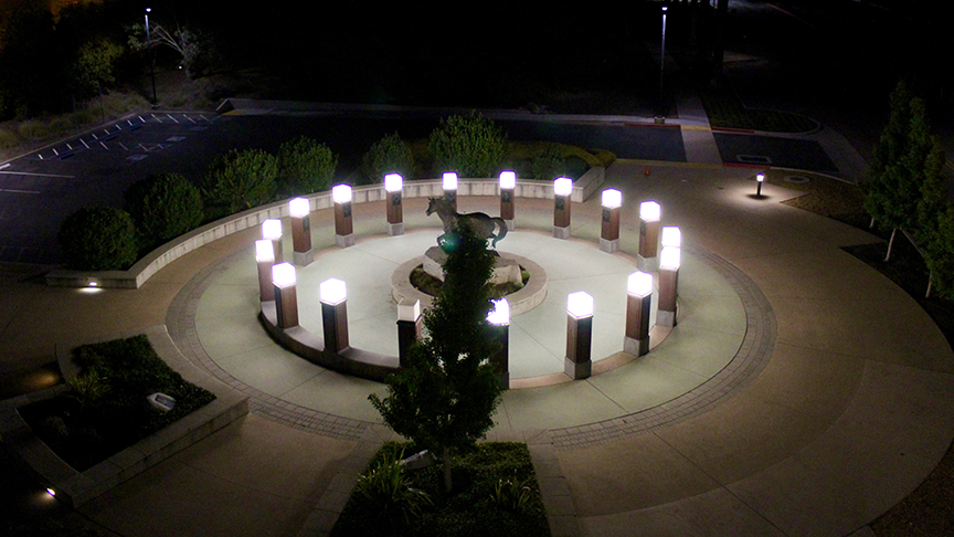 Mustang Memorial Plaza at night