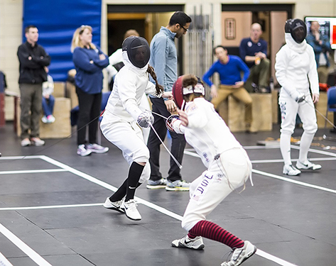 Photo of two athletes fencing